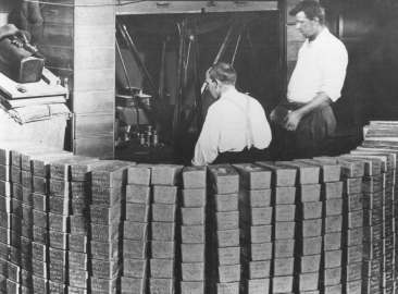 Weighing silver bars c1920