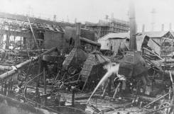 """On 25 January 1921 a catastrophic fire in the Dwight and Lloyd Roasting Plant brought the smelter to a standstill. The fire damage was estimated in excess of £100,000 and permanent replacement would take a minimum of 12 months. Amidst union activity and health concerns for workers, the plant was rebuilt and recommenced operations in August 1921. Source: Ken Bullock, Port Pirie: The Undaunted Years, p 94-96 From The Recorder (Port Pirie), 26 January 1921 """"Yesterday was the seventh day on which the temperature reached at least 100 degrees in the shade. Everything was dry and susceptible to fire. Without much stretch of the imagination it could be said that wood work was cracking, almost crackling. It was hot to touch. So that it needed but a lick of fire to burst into flame. A strong, scorching wind made matters worse. Opinions vary as to the exact time at which the fire broke out. It was near to 3 o'clock in the afternoon. A gust of wind and perhaps some other coincidental event combined, and a tongue of flame leapt out of the burner, flicked a piece of woodwork near by, and the place was alight."""""""